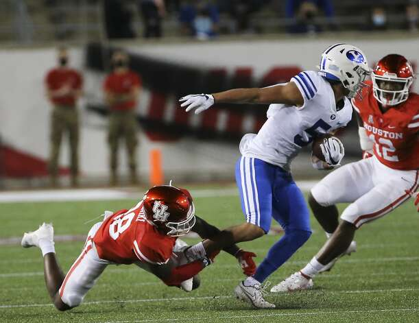 Brigham Young Cougars wide receiver Dax Milne (5) gets out of a tackle by Houston Cougars safety Thabo Mwaniki (28) during the first quarter Friday, Oct. 16, 2020, at TDECU Stadium in Houston. Photo: Yi-Chin Lee/Staff Photographer / © 2020 Houston Chronicle