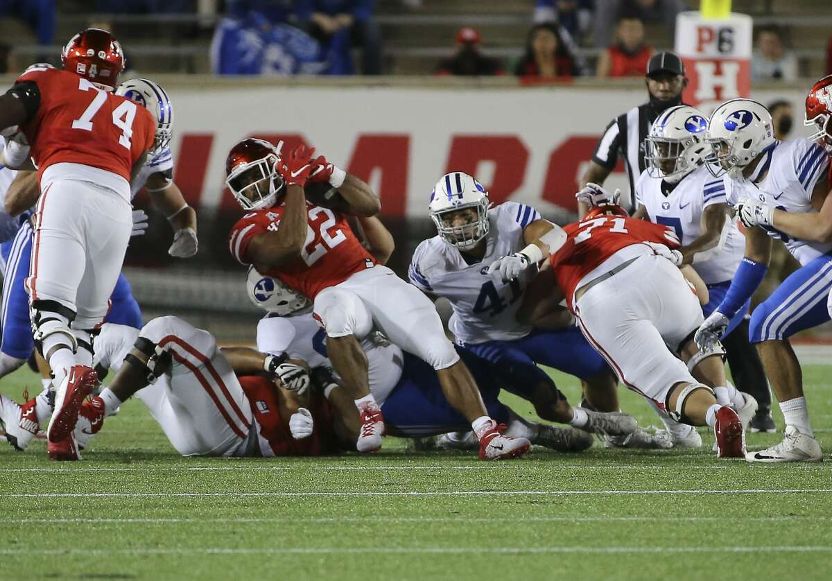 Houston Cougars running back Kyle Porter (22) makes a down during the second quarter against the Brigham Young Cougars Friday, Oct. 16, 2020, at TDECU Stadium in Houston.