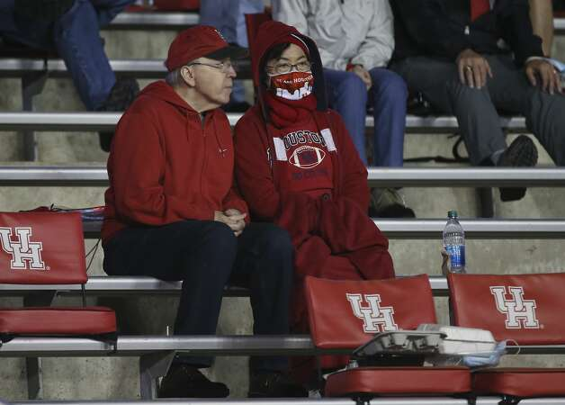 With the temperature dropping, Houston Cougars fans trying to stay warm during the third quarter against the Brigham Young Cougars Friday, Oct. 16, 2020, at TDECU Stadium in Houston. Photo: Yi-Chin Lee/Staff Photographer / © 2020 Houston Chronicle