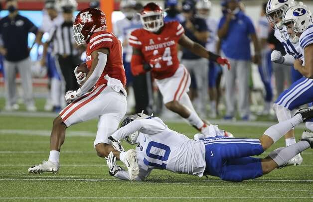 Houston Cougars cornerback Damarion Williams (6) dodges a tackle by Brigham Young Cougars defensive back Morgan Pyper (10) during the second quarter Friday, Oct. 16, 2020, at TDECU Stadium in Houston. Photo: Yi-Chin Lee/Staff Photographer / © 2020 Houston Chronicle