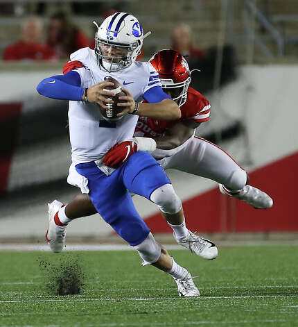 Brigham Young Cougars quarterback Zach Wilson (1) is tackled by Houston Cougars defensive lineman David Anenih (12) during the second quarter Friday, Oct. 16, 2020, at TDECU Stadium in Houston. Photo: Yi-Chin Lee/Staff Photographer / © 2020 Houston Chronicle