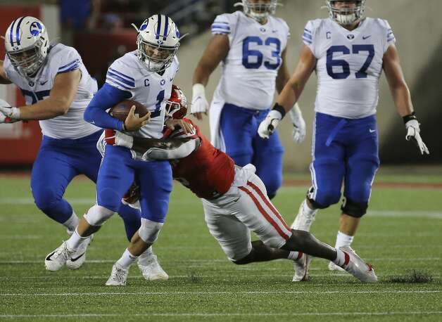 Brigham Young Cougars quarterback Zach Wilson (1) is tackled by Houston Cougars linebacker Donavan Mutin (3) during the third quarter Friday, Oct. 16, 2020, at TDECU Stadium in Houston. Photo: Yi-Chin Lee/Staff Photographer / © 2020 Houston Chronicle