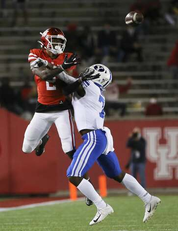 Houston Cougars safety Deontay Anderson (2) is interfered by Brigham Young Cougars defensive back George Udo (7) during the third quarter Friday, Oct. 16, 2020, at TDECU Stadium in Houston. Photo: Yi-Chin Lee/Staff Photographer / © 2020 Houston Chronicle