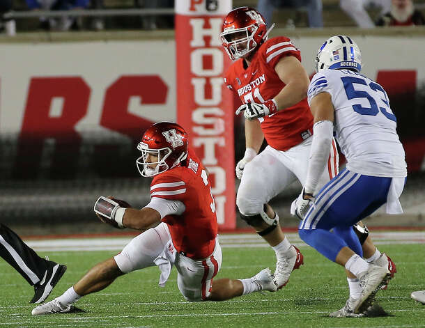 Houston Cougars quarterback Clayton Tune (3) goes down while running the ball during the fourth quarter against the Brigham Young Cougars Friday, Oct. 16, 2020, at TDECU Stadium in Houston. Photo: Yi-Chin Lee/Staff Photographer / © 2020 Houston Chronicle