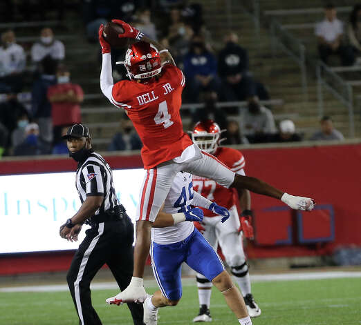 Houston Cougars wide receiver Nathaniel Dell (4) catches a pass and makes a down during the first quarter against the Brigham Young Cougars Friday, Oct. 16, 2020, at TDECU Stadium in Houston. Photo: Yi-Chin Lee/Staff Photographer / © 2020 Houston Chronicle