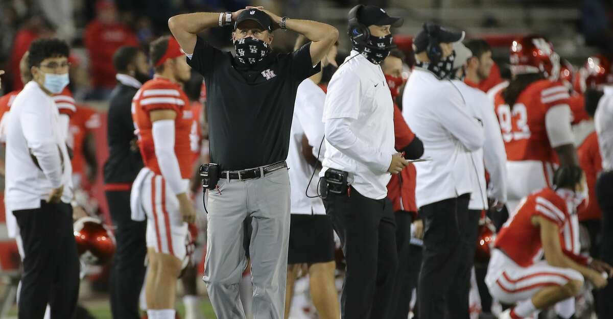 Houston Cougars head coach Dana Holgorsen walks down the sideline during the fourth quarter against the Brigham Young Cougars Saturday, Oct. 17, 2020, at TDECU Stadium in Houston.