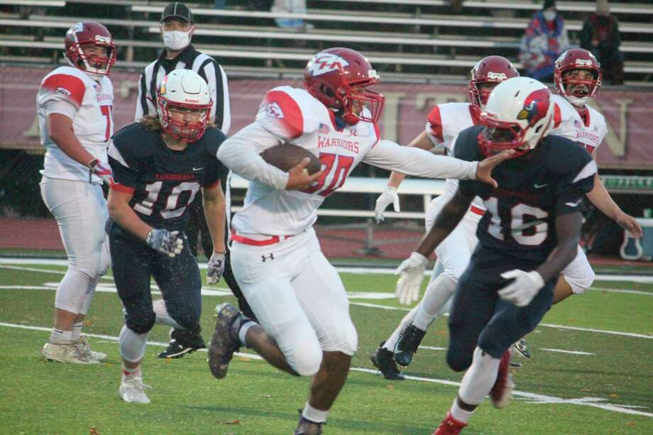 Chippewa Hills' Gage Todd (30) looks for running room earlier this season. (Pioneer file photo)