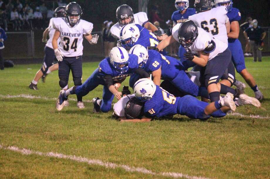Morley Stanwood's defense makes the play in recent action this season. (Pioneer file photo)