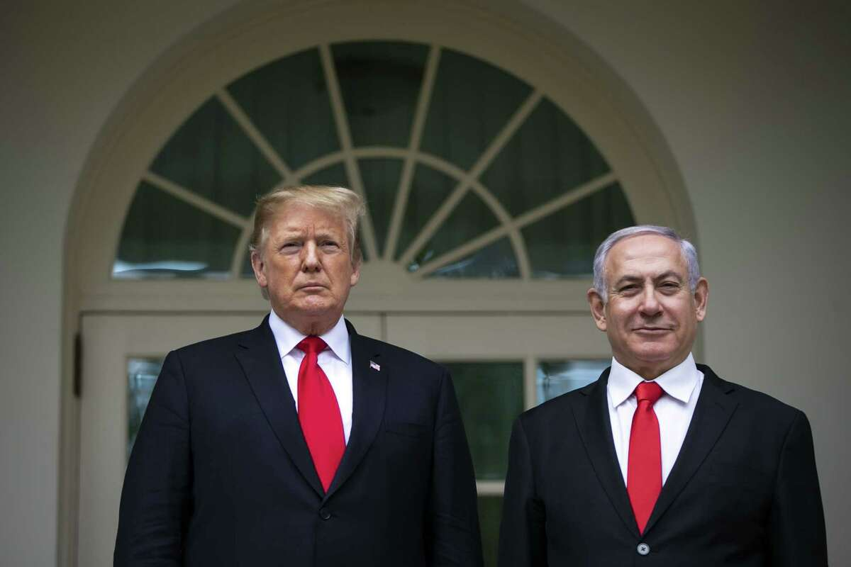 President Donald Trump and Benjamin Netanyahu, Israel's prime minister, right, stand for a photograph in the Rose Garden of the White House in Washington on March 25, 2019.