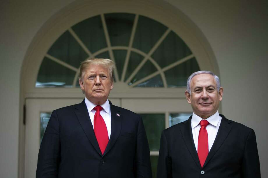 President Donald Trump and Benjamin Netanyahu, Israel's prime minister, right, stand for a photograph in the Rose Garden of the White House in Washington on March 25, 2019. Photo: Bloomberg Photo By Al Drago. / © 2019 Bloomberg Finance LP