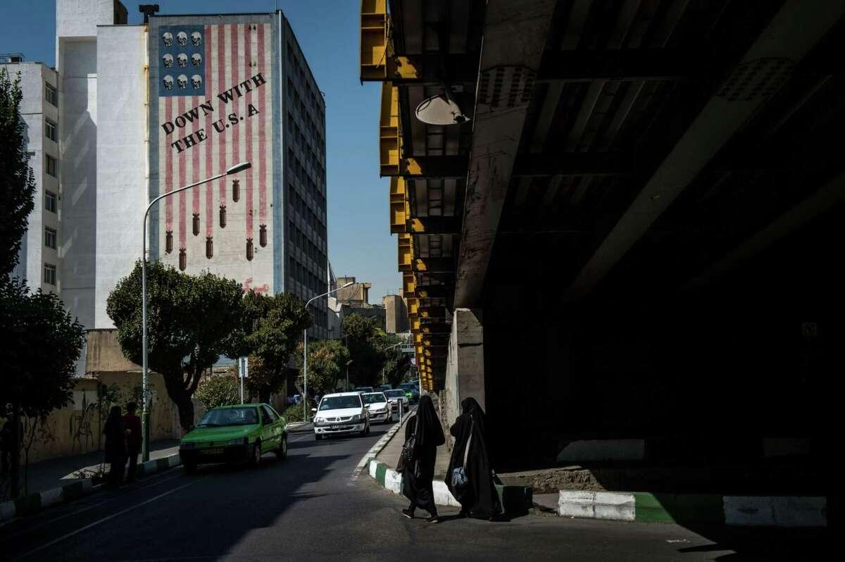 Pedestrians walk through an overpass in Tehran, Iran, on Sept. 18, 2019.