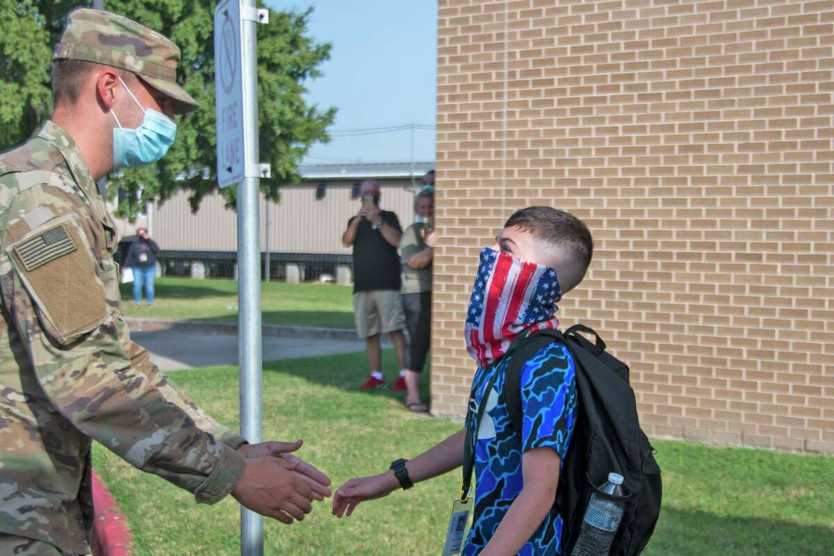Cy Falls graduate Pct. Camden Handy surprises his younger brother Kyle at Horne Elementary in Cy-Fair ISD on Oct. 13, 2020.