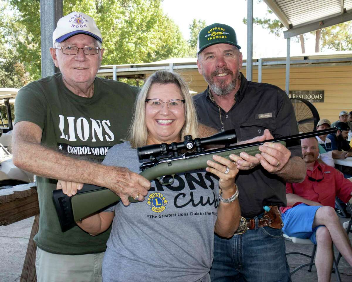 It was a bang up good time during the Conroe Noon Lions Club Clay Shoot last weekend as seen here during the Gun Raffle; pictured (l-r) Bob Gunter, Caroline McWilliams, Clyde Messer.