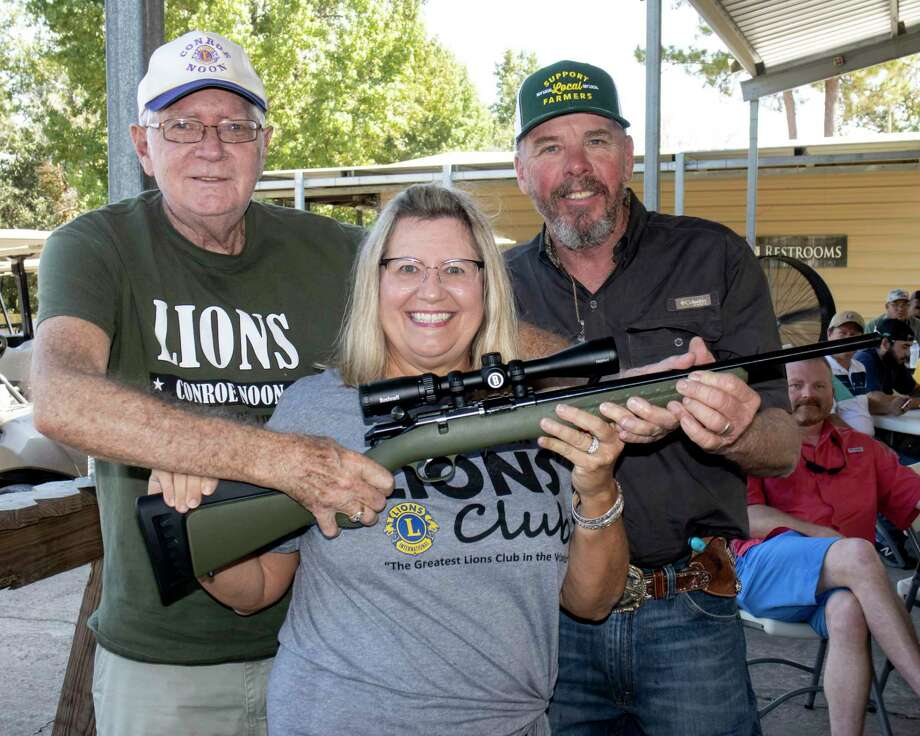 It was a bang up good time during the Conroe Noon Lions Club Clay Shoot last weekend as seen here during the Gun Raffle; pictured (l-r) Bob Gunter, Caroline McWilliams, Clyde Messer. Photo: Courtesy Photo / cc.phototx@gmail.com