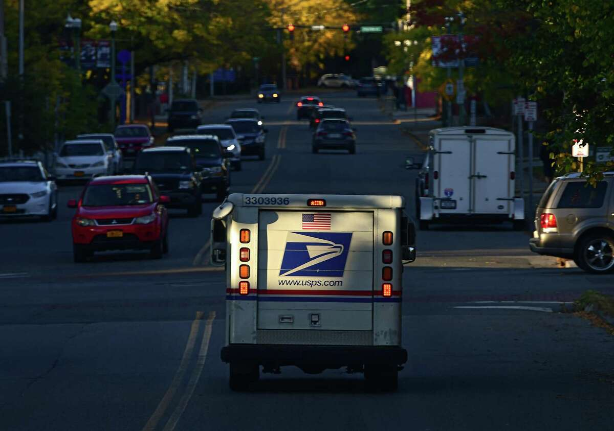 A United State Postal Service truck carrying mail drives down 6th Ave. on Wednesday, Oct. 14, 2020 in Troy, N.Y. (Lori Van Buren/Times Union)