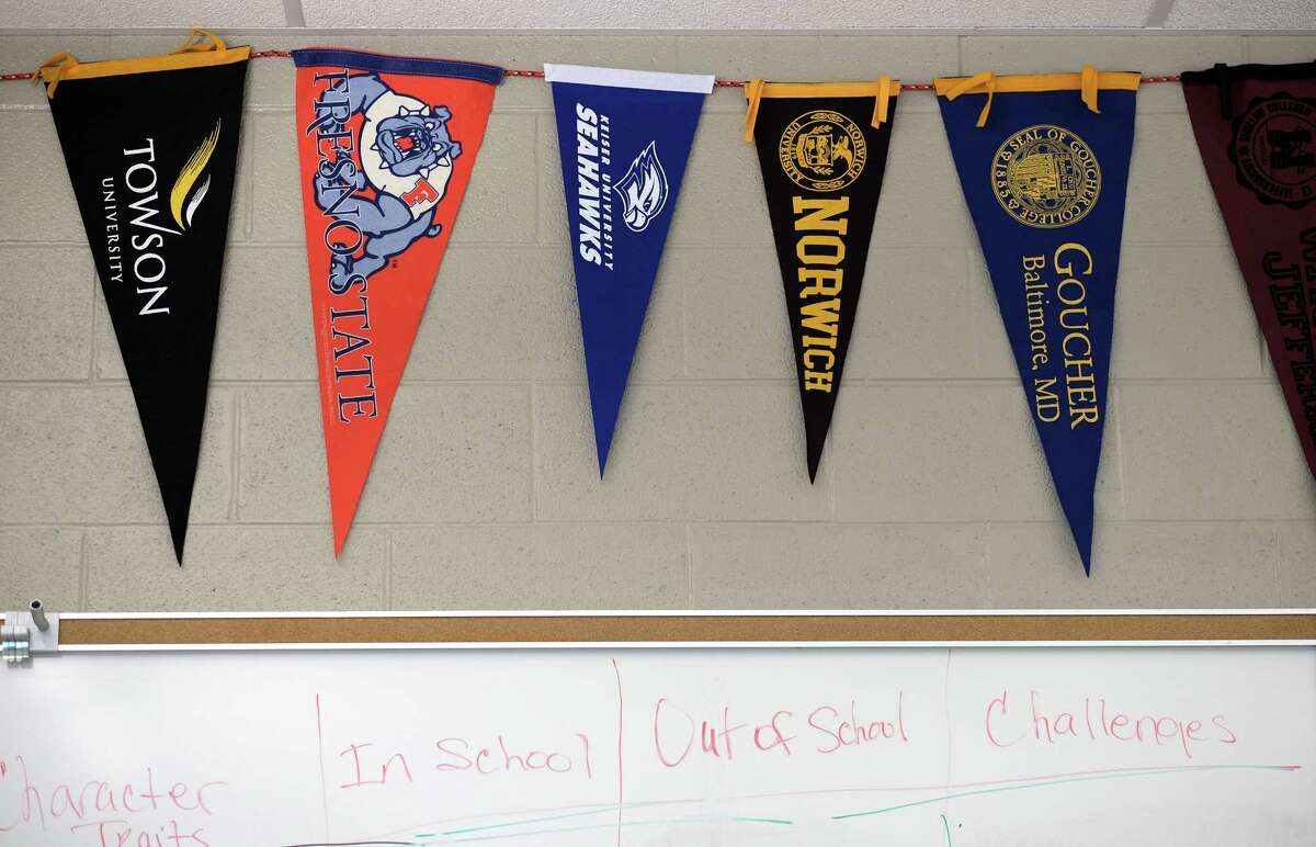 College penants hang in a classroom at Wheaton High School in Wheaton, Md., on Oct. 17, 2017.