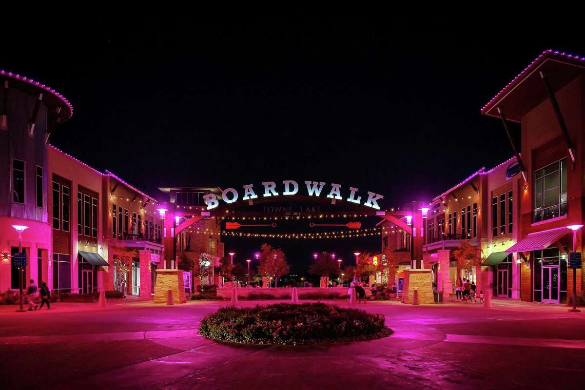 The Boardwalk at Towne Lake in northwest Houston is awash in pink with 2,000 lights recognizing Breast Cancer Awareness month this October. Every night of the month, from the rooftops to the green space area and bistro lights strung across the green, the lighting display sponsored by Houston Methodist shines a light on prevention, detection, and treatment.