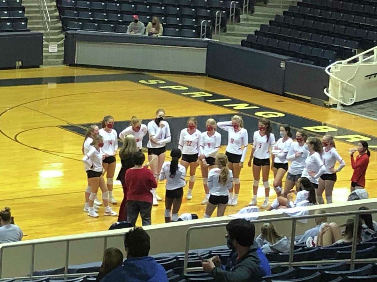 Memorial coach Kaddie Platt talks to her team during a timeout during Memorial's match against Cy Creek at Don Coleman Coliseum on Oct. 16