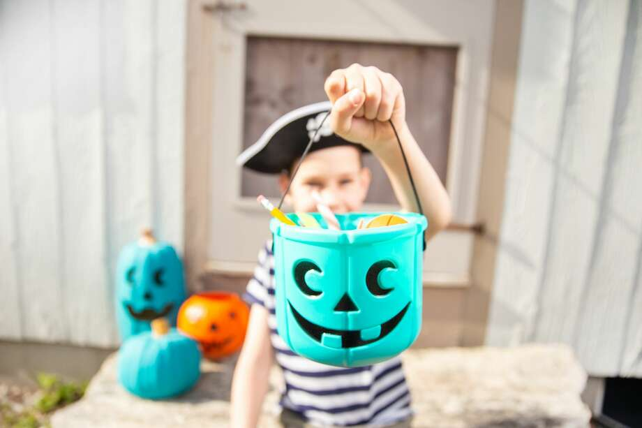The Teal Pumpkin Project is designed to signal alternative non-food treats for kids with food allergies. Photo: Evgenii And