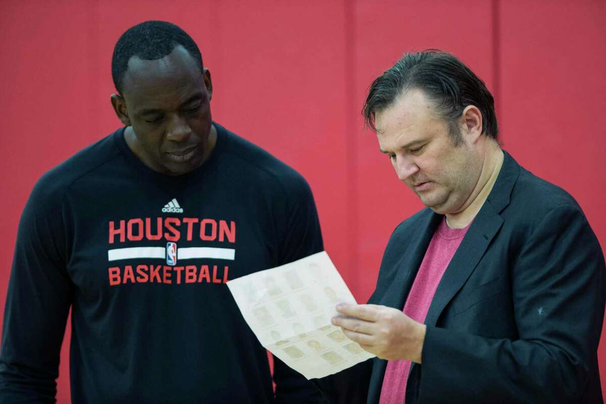 Daryl Morey, talking with former assistant coach Roy Rogers in 2017, embraced analytics as general manager but didn't do it at the expense of in-person scouting and evaluations.