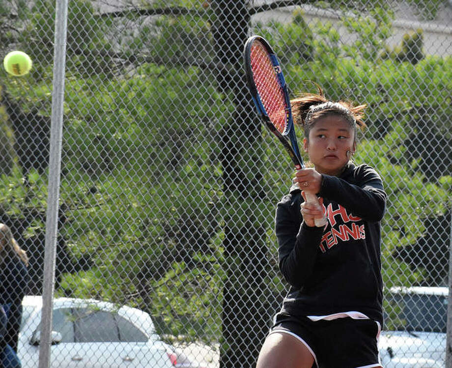 Edwardsville sophomore Chloe Koons powers a return shot with her backhand during her singles championship match in the Class 2A Edwardsville Sectional on Saturday. Photo: Matt Kamp|The Intelligencer