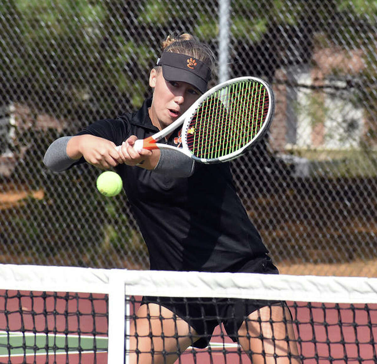Edwardsville junior Hannah Colbert returns a shot from in front of the net during her doubles championship match in the Class 2A Edwardsville Sectional on Saturday.