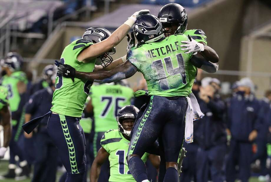 SEATTLE, WASHINGTON - OCTOBER 11: DK Metcalf #14 of the Seattle Seahawks is congratulated by teammates after scoring the game winning touchdown against the Minnesota Vikings during the fourth quarter at CenturyLink Field on October 11, 2020 in Seattle, Washington. (Photo by Abbie Parr/Getty Images) Photo: Abbie Parr/Getty Images / 2020 Getty Images