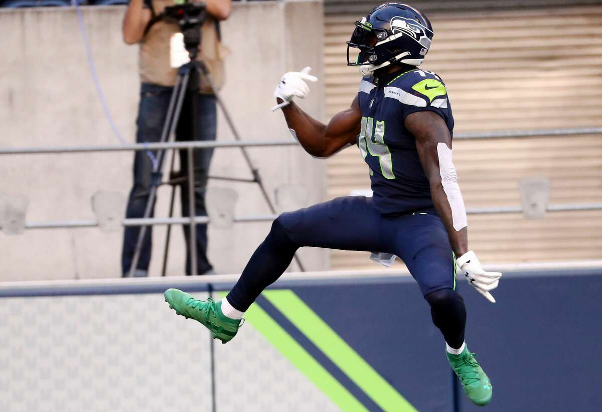 SEATTLE, WASHINGTON - SEPTEMBER 20: DK Metcalf #14 of the Seattle Seahawks celebrates scoring a second quarter touchdown against the New England Patriots at CenturyLink Field on September 20, 2020 in Seattle, Washington. (Photo by Abbie Parr/Getty Images)