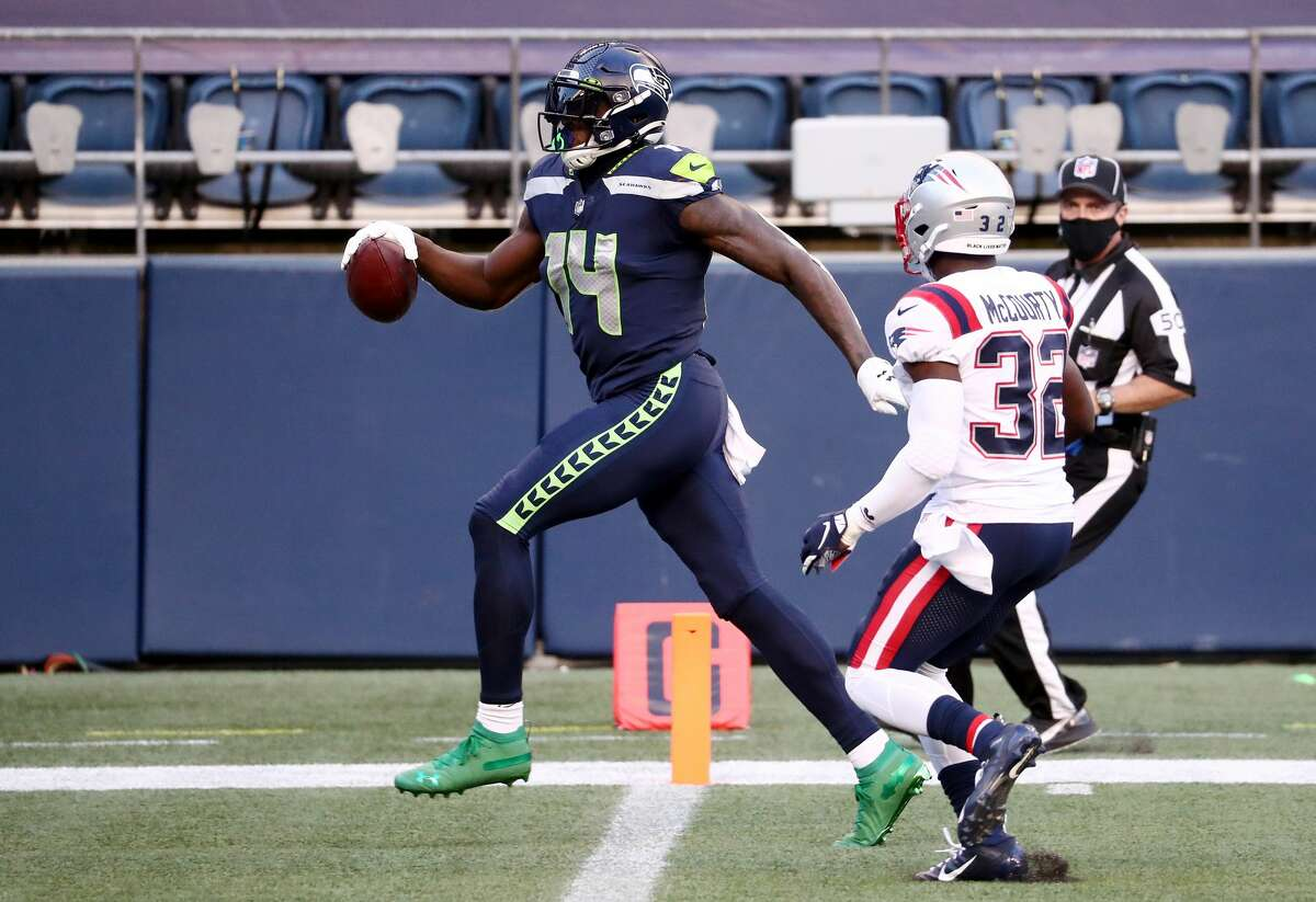 SEATTLE, WASHINGTON - SEPTEMBER 20: DK Metcalf #14 of the Seattle Seahawks scores a second quarter touchdown against the New England Patriots at CenturyLink Field on September 20, 2020 in Seattle, Washington. (Photo by Abbie Parr/Getty Images)