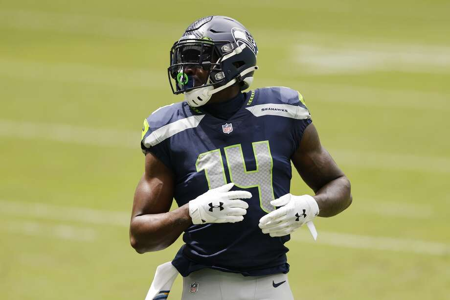 MIAMI GARDENS, FLORIDA - OCTOBER 04: DK Metcalf #14 of the Seattle Seahawks looks on against the Miami Dolphins during the second half at Hard Rock Stadium on October 04, 2020 in Miami Gardens, Florida. (Photo by Michael Reaves/Getty Images) Photo: Michael Reaves/Getty Images / 2020 Michael Reaves