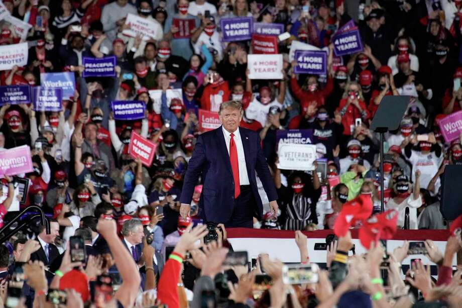 President Trump greets the crowd at a rally in Macon, Ga., on Friday night. Photo: Photo By Nicole Craine For The Washington Post / For The Washington Post