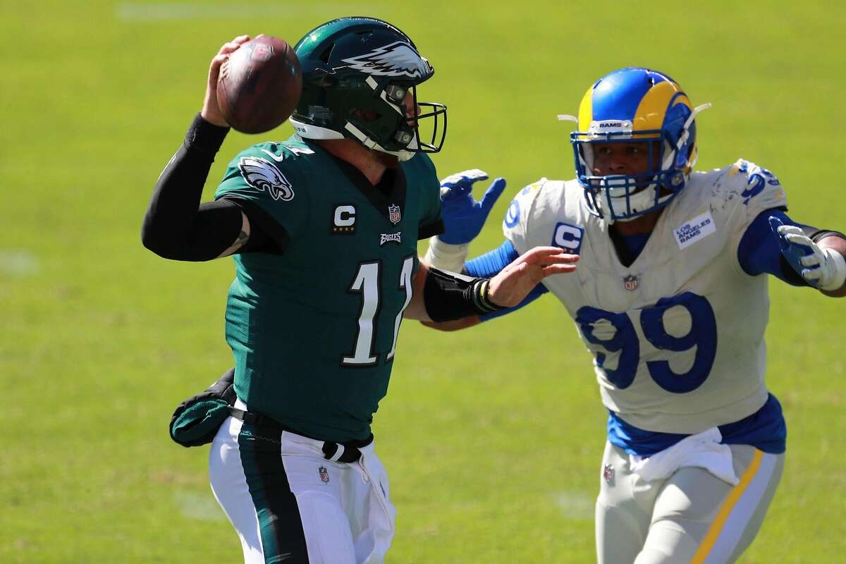 Rams defensive end Aaron Donald (99), shown closing in on Eagles quarterback Carson Wentz in September, comes into Sunday night's game against San Francisco with 11½ sacks and 14 tackles for loss in 11 games against the 49ers.