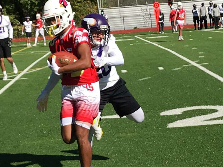 Greenwich senior A.J. Barber looks to gain yards after making a reception in the Cardinals' 7-on-7 football game against Westhill on Saturday, October 17, 2020 in Greenwich, Connecticut. Photo: David Fierro /Hearst Connecticut Media
