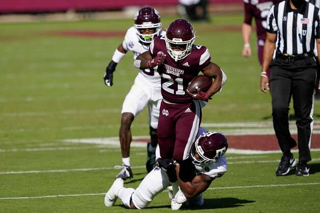 Mississippi State running back Jo'quavious Marks (21) runs for a first down as he is tackled by a Texas A&M defender during the first half of an NCAA college football game in Starkville, Miss., Saturday, Oct. 17, 2020. (AP Photo/Rogelio V. Solis) Photo: Rogelio V. Solis, Associated Press / Copyright 2020. The Associated Press. All rights reserved