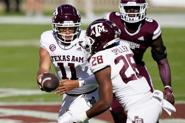 Texas A&M quarterback Kellen Mond (11) hands off to running back Isaiah Spiller (28) during the first half of an NCAA college football game against Mississippi State in Starkville, Miss., Saturday, Oct. 17, 2020. (AP Photo/Rogelio V. Solis) Photo: Rogelio V. Solis, Associated Press / Copyright 2020. The Associated Press. All rights reserved