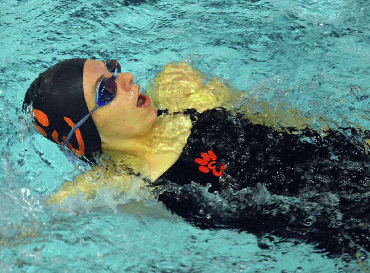 Edwardsville's Sylvia Knolhoff competes in the 100-yard backstroke at the Southern Illinois High School Girls Championships on Saturday at Chuck Fruit Aquatic Center.