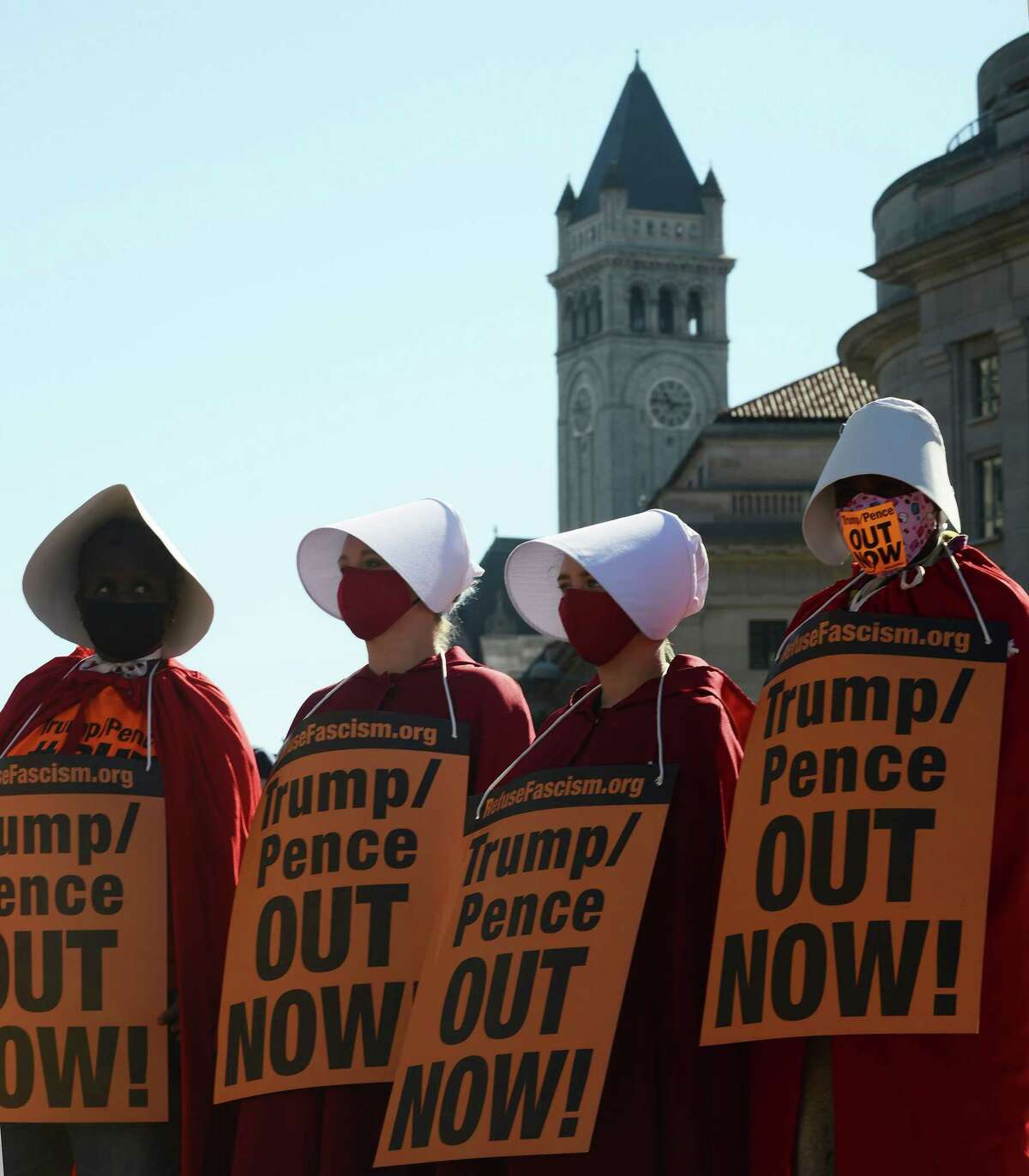 Women dressed as handmaidens to protest Supreme Court nominee Amy Coney Barrett on Oct. 17, 2020.