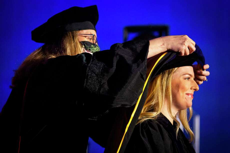 A law student participates during a full day of commencement ceremonies for the South Texas College of Law Houston on Saturday. Photo: Annie Mulligan, Houston Chronicle / Contributor / © 2020 Annie Mulligan / Houston Chronicle