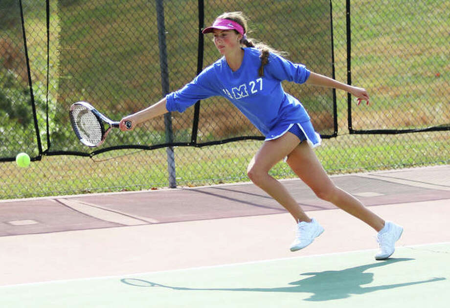Marquette Catholic's Monica Wendle extends, but cannot make a return during her No. 1 singles championship match Saturday at the Althoff Class 1A Sectional girls tennis tournament in Belleville. Photo: Greg Shashack / The Telegraph