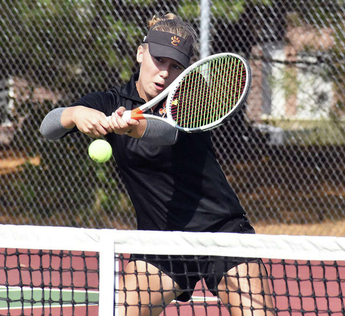 Edwardsville's Hannah Colbert returns a shot during her doubles match Saturday at the Edwardsville Class 2A Sectional at the EHS courts in Edwardsville. Colbert teamed with Chloe Trimpe to win the doubles championship.