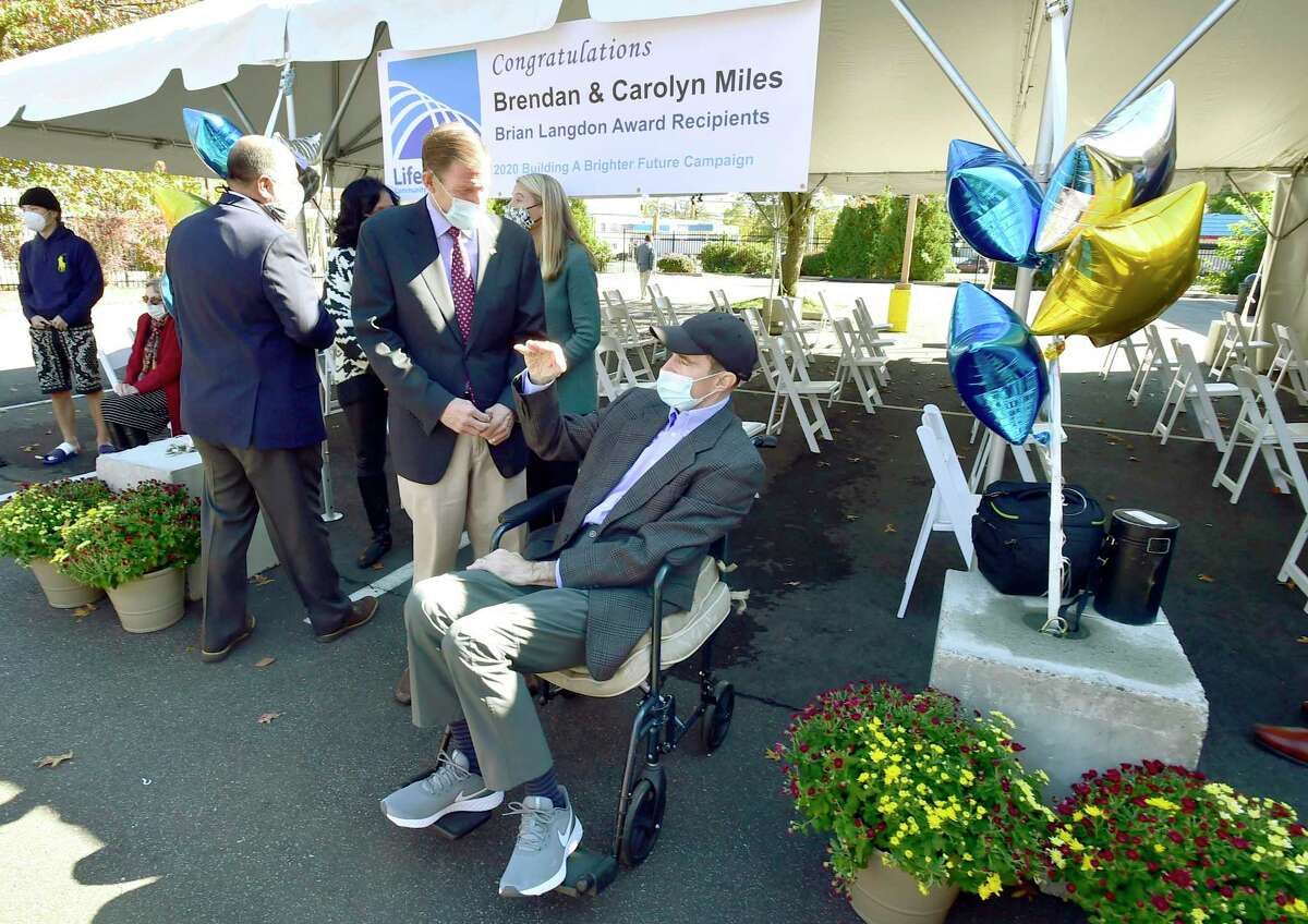 Bridgeport, Connecticut - Saturday, October 17, 2020: U.S. Senator Richard Blumenthal, left, speaks with Brendan Miles before LifeBridge Community Services of Bridgeport honors Brendan and Carolyn Miles of Southport, Conn. with the Brian Langdon Award Saturday for their work helping raise more than $400,000 to support youth in Bridgeport through one of LifeBridge's programs, created in February.