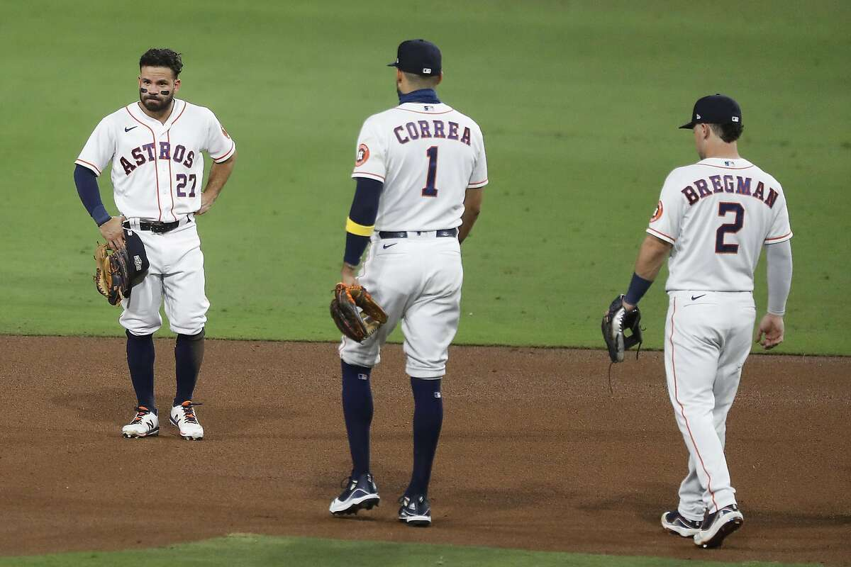 Houston's Jose Altuve, left, stands on the infield as teammates Carlos Correa and Alex Bregman walk over to him after Altuve committed an error on a grounder by Tampa Bay's Brandon Lowe in Game 3 of last year's American League Championship Series.