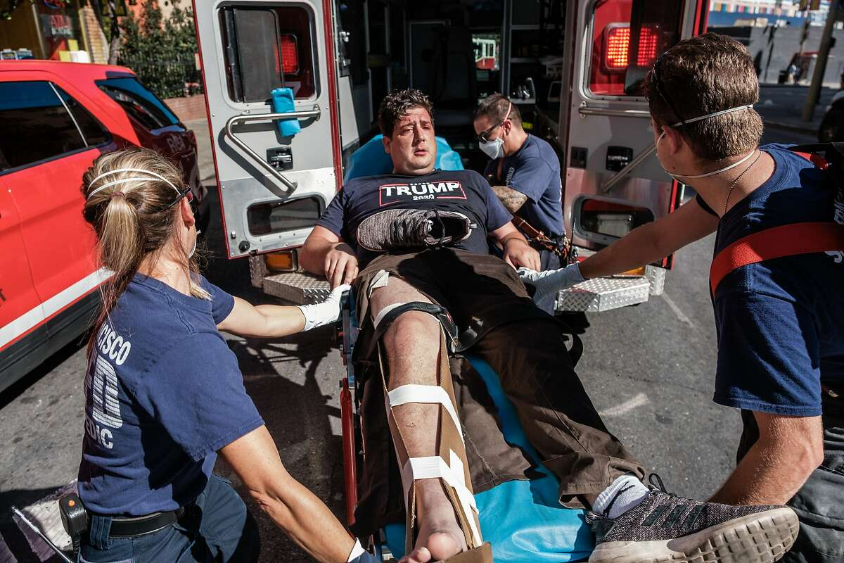A Trump supporter is wheeled into an ambulance after he was attacked by counter protester at a free speech rally and protest in San Francisco on Saturday.