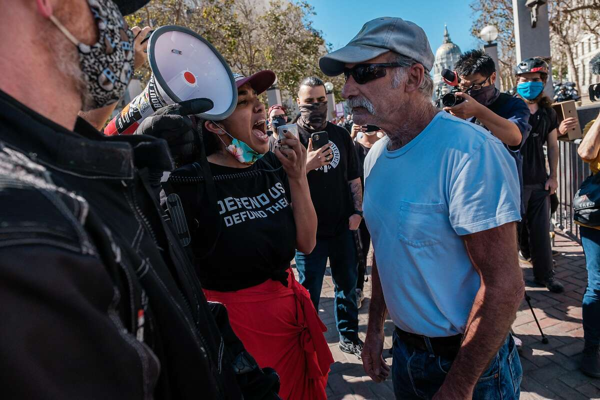 A counterprotester yells at a President Trump supporter attending a free speech rally at United Nations Plaza in S.F. The Trump supporter was later injured in an attack by counterprotesters.