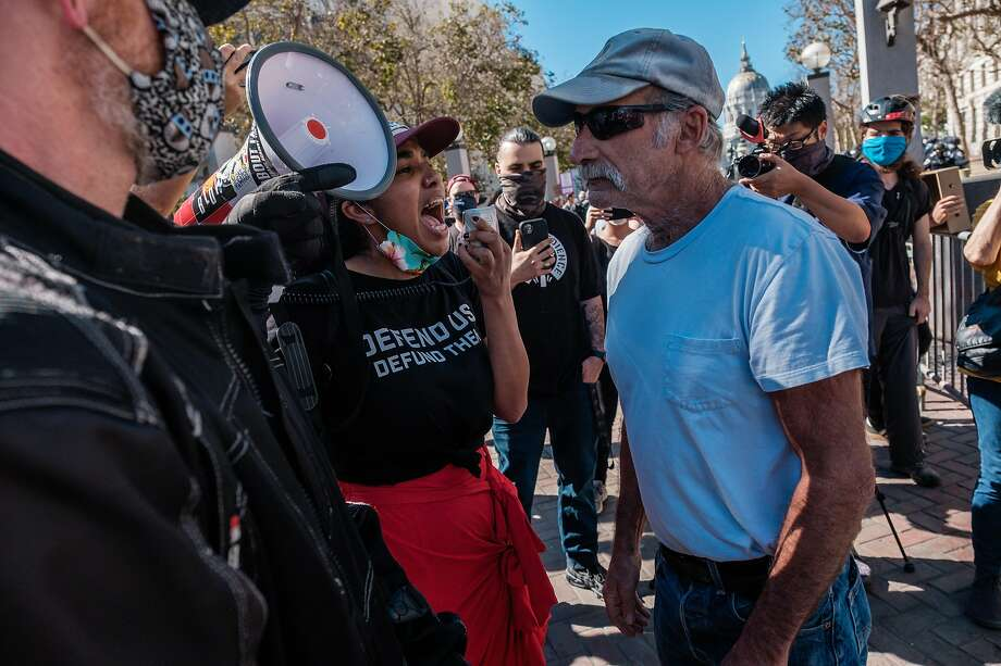 A counterprotester yells at a President Trump supporter attending a free speech rally at United Nations Plaza in S.F. The Trump supporter was later injured in an attack by counterprotesters. Photo: Nick Otto / Special To The Chronicle