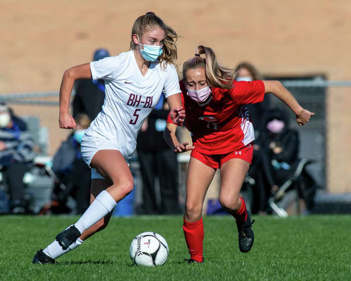 Burnt Hills Ballston Lake midfielder Ella Blesi (5) and Guilderland midfielder Paige Miller (11) race to the ball during a Suburban Council matchup at Guilderland High School in Guilderland, NY, on Saturday, Oct. 17, 2020 (Jim Franco/special to the Times Union.)