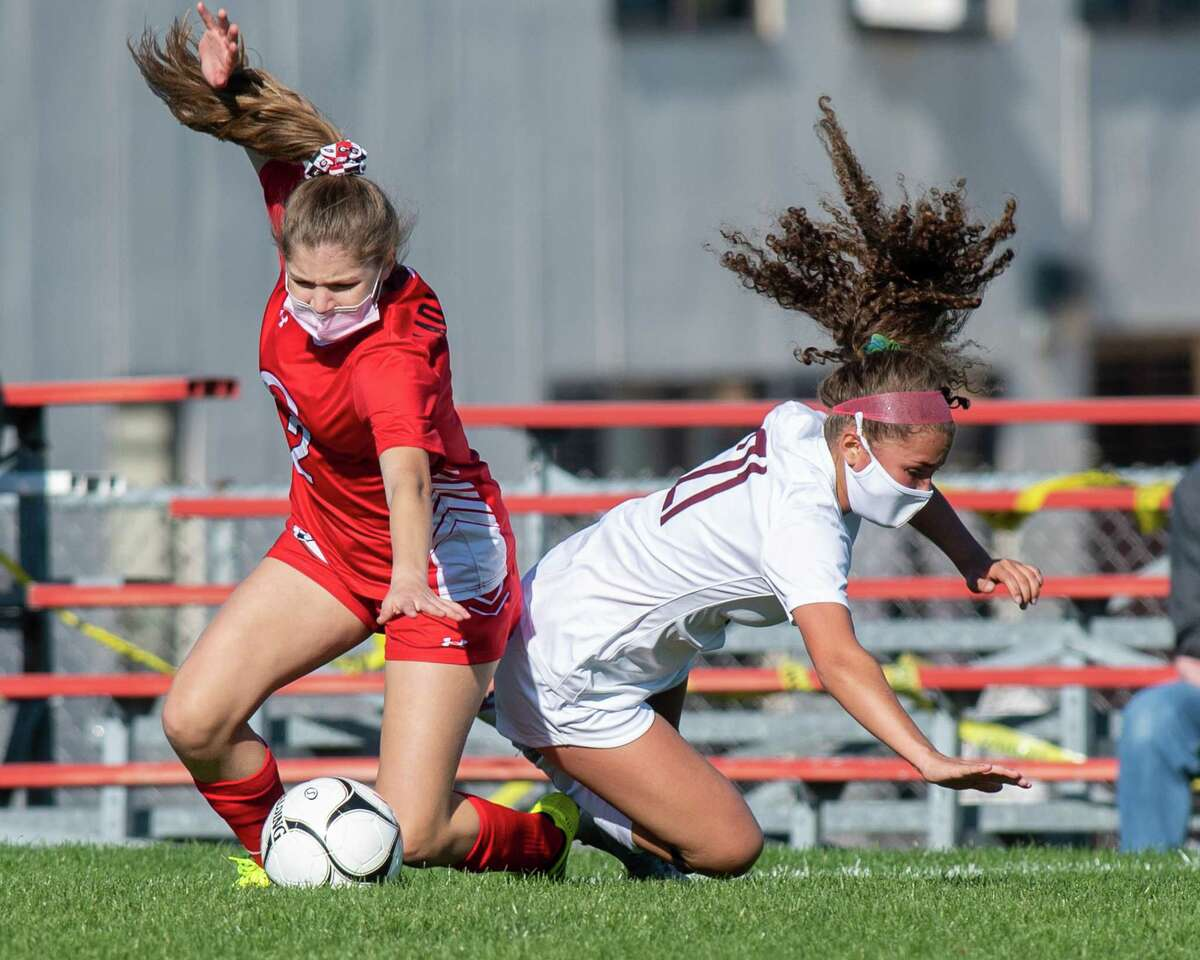 Guilderland midfielder Maya Kerr (2) battles with Burnt Hills Ballston Lake midfielder Katie Ramos (21) during a Suburban Council matchup at Guilderland High School in Guilderland, NY, on Saturday, Oct. 17, 2020 (Jim Franco/special to the Times Union.)