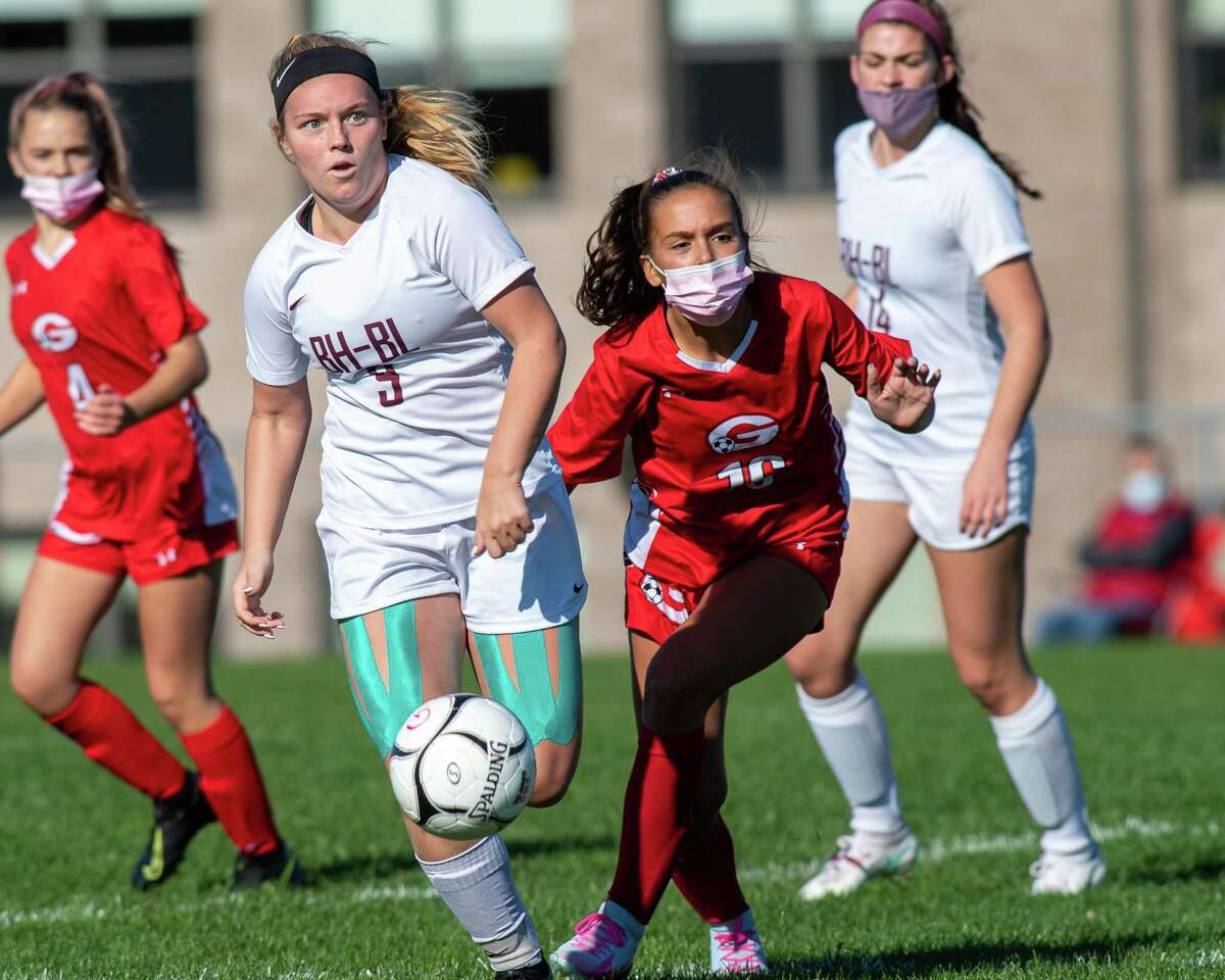 Burnt Hills Ballston Lake defender Camden Woodbeck (9) and Guilderland forward Jenna Meier (16) battle for position during a Suburban Council matchup at Guilderland High School in Guilderland, NY, on Saturday, Oct. 17, 2020 (Jim Franco/special to the Times Union.)