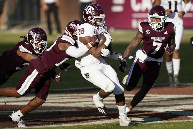 Texas A&M running back Isaiah Spiller (28) drags a Mississippi State defender as he picks up short yardage during the second half of an NCAA college football game in Starkville, Miss., Saturday, Oct. 17, 2020. (AP Photo/Rogelio V. Solis) Photo: Rogelio V. Solis/Associated Press / Copyright 2020. The Associated Press. All rights reserved