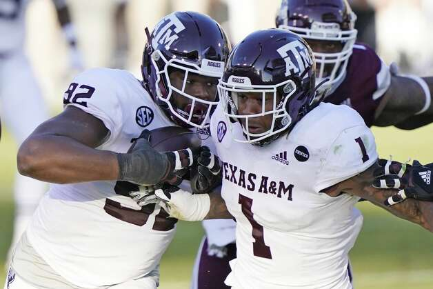 Texas A&M defensive lineman Jayden Peevy (92) recovers a fumble and is escorted downfield by linebacker Buddy Johnson (1) during the second half of an NCAA college football game in Starkville, Miss., Saturday, Oct. 17, 2020. Peevy did not score. (AP Photo/Rogelio V. Solis) Photo: Rogelio V. Solis/Associated Press / Copyright 2020. The Associated Press. All rights reserved